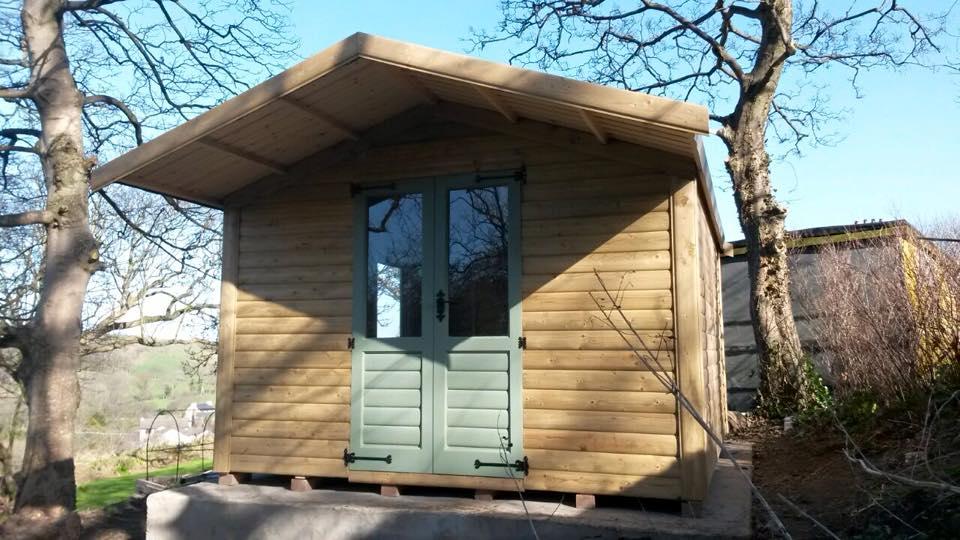 Tanalised log summerhouse with overhang double glazed doors